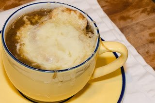 Cup of French Onion Soup with Melted Cheese