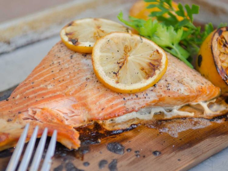 Slow Roasted Salmon Grilled on a Cedar Plank with Lemons and Herbs