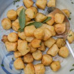 Serving bowl with cauliflower gnocchi tossed in brown butter with fresh sage