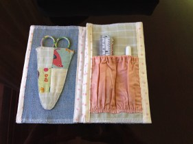 Inside Isobel's needle book, showing scissor keeper and pockets for doodads