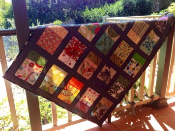 """Windows"" quilt on balcony"