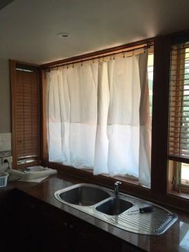 Full length curtains, closed.