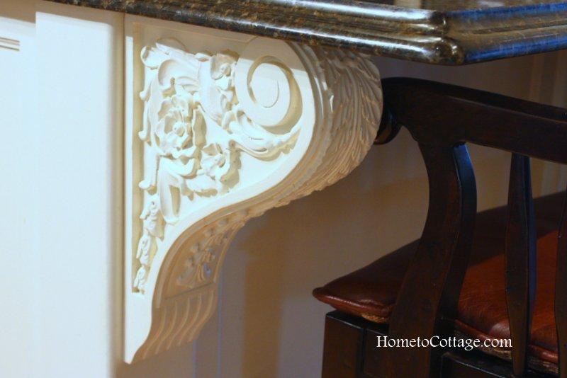 HometoCottage.com carved corbel bracket on island