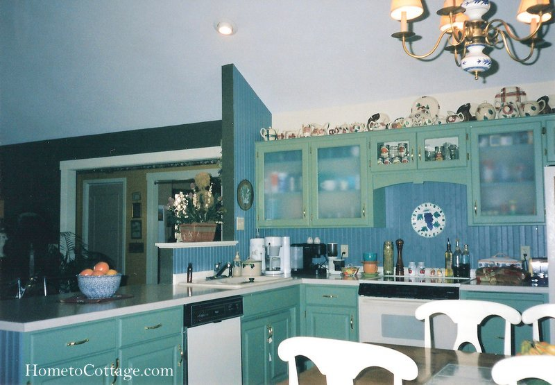 HometoCottage.com kitchen after phase 1 showing old sink and appliances and peninsula