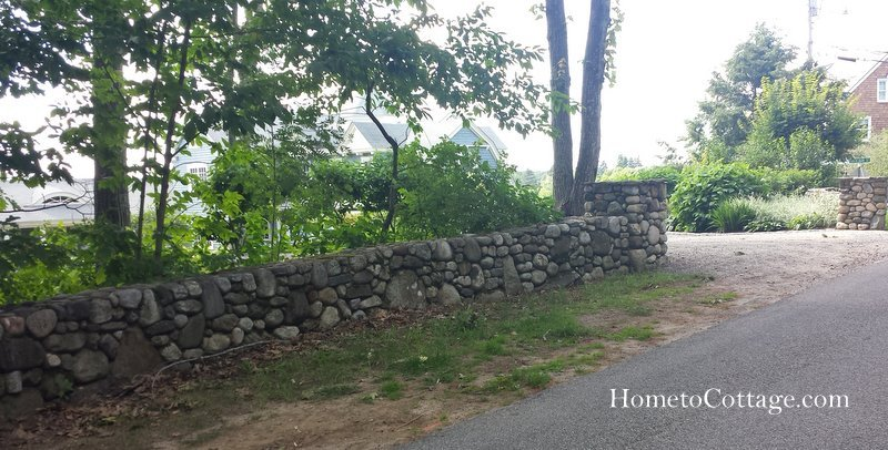 HometoCottage.com rock fence with pillars at driveway.