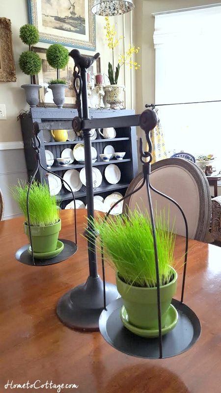 HometoCottage.com reproduction vintage scale with grass growing in pots