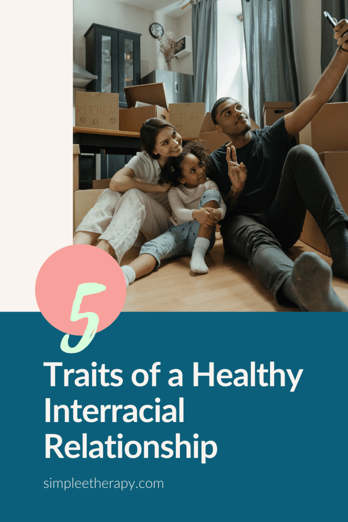 5 traits of a healthy interracial relationship, interracial couple sitting with their child in front of moving boxes