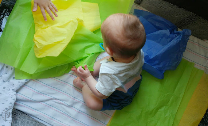 baby play tissue paper - discovering the world through simple sensory play, create a place for play