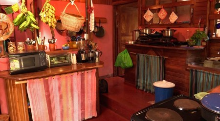 Photograph of the kitchen in the main house.