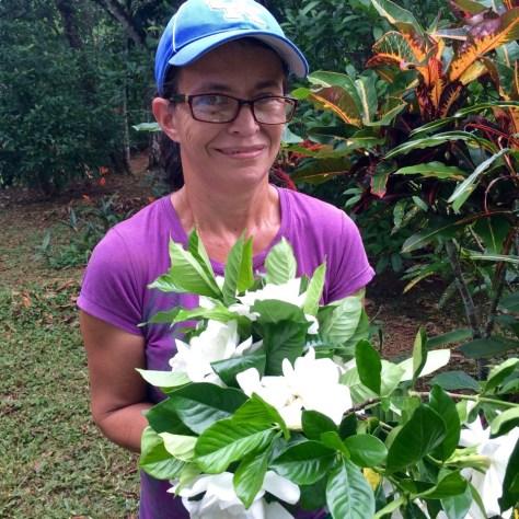 Photograph of long time Refugio de Los Angeles employee Sonia Ramirez with a bouquet of fresh cut gardenias.
