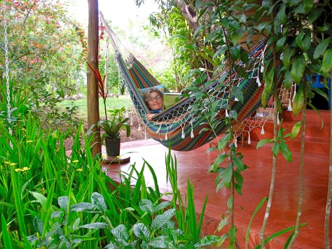Jane White rests in a hammock on the front porch of Refugio de Los Angeles