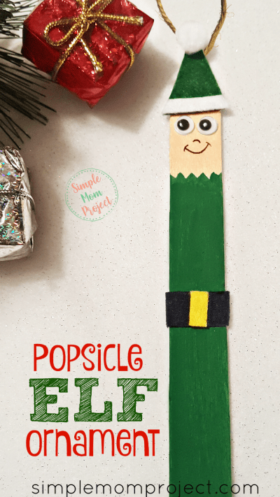 Have fun with these easy homemade Stable Popsicle Stick Christmas Ornaments! Share in the classroom, at home, or to go along with your Sunday school lesson. These awesome Popsicle Stick Ornaments are easy enough for any kid to make for a gift ideas or to be hung on the Christmas tree! #elfornament #Christmas #diyornament
