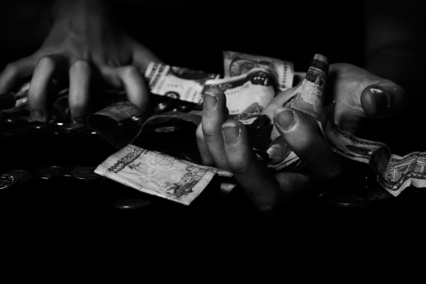 gambling greed scrounging for money