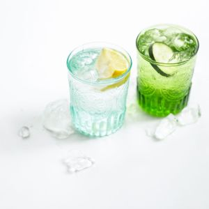 two glasses of water with lemon and cucumber