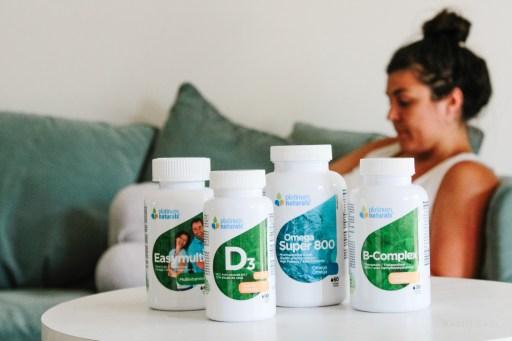 women sitting with Platinum Naturals vitamins