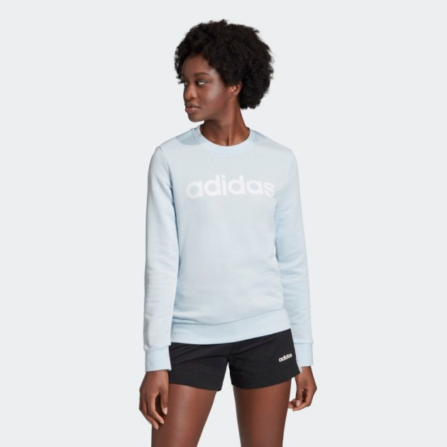 Woman wearing Adidas Essentials Linear Sweatshirt Sky Tint Mother's Day Gift Ideas