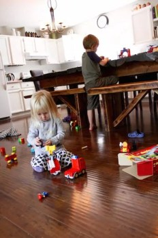kids playing lego quietly in kitchen