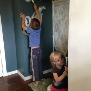toddlers painting bedroom walls