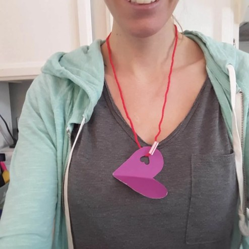 woman with homemade heart necklace
