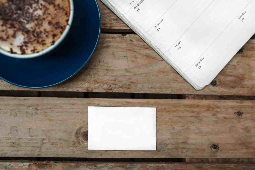 planner and coffee on a table