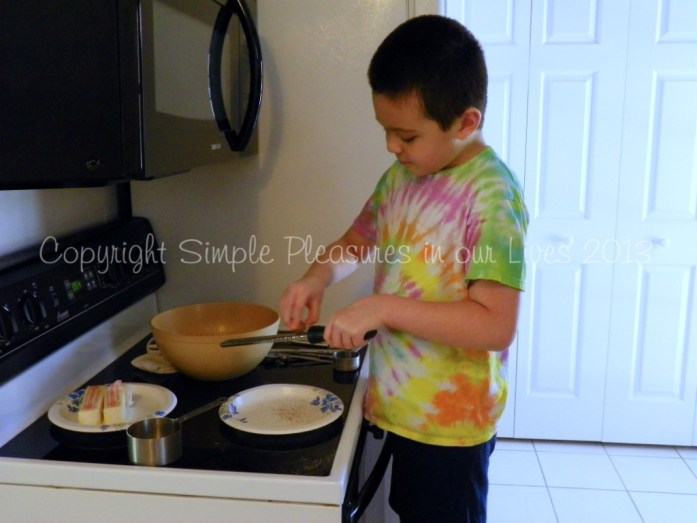 Alex (although he was not feeling well) wanted to help me bake - here he was, grating the nutmeg. :D