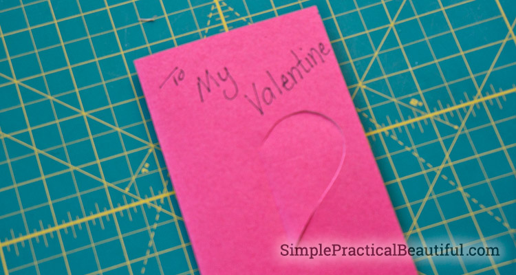 Fold the heart of the Valentine card