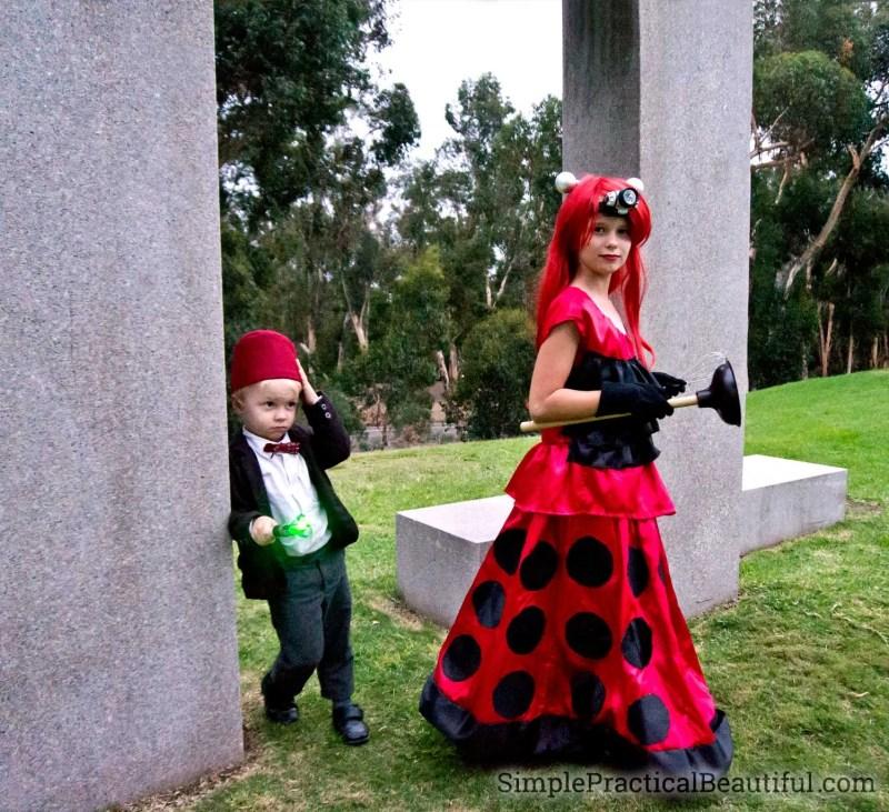 A Dalek costume dress and a mini 11th Doctor