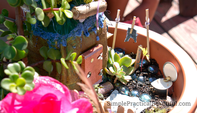 How to create a small fairy garden in a flower pot, including supplies you need and tips for making it look more magical