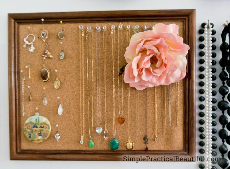cork in a frame holds necklaces