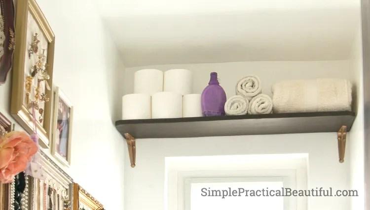 Store necessities on a bathroom shelf