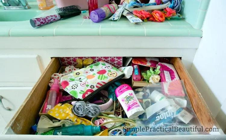 Before the bathroom drawer organizer