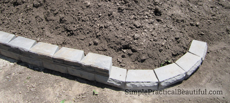 How to build a small retaining wall with interlocking bricks