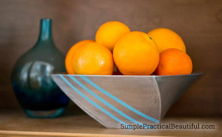 An upcycled metal bowl with a brushed finish