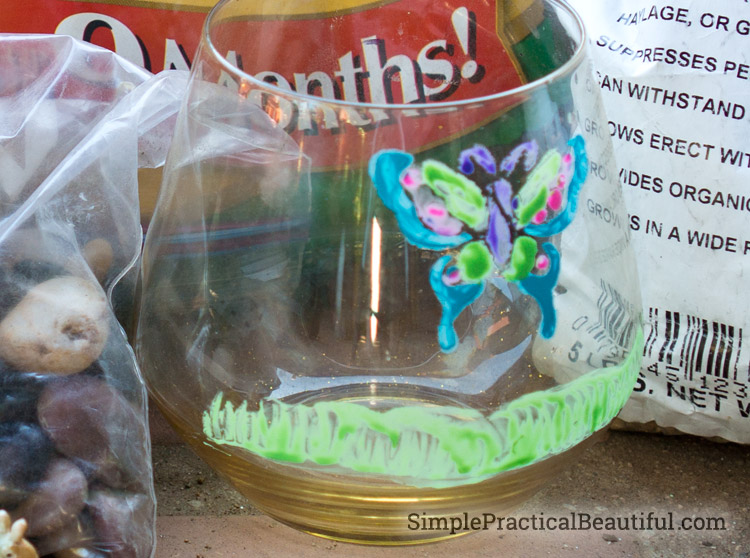 Acrylic paint with a stencil decorates the terrarium