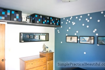 A high shelf is a great place for storage, and the metallic paint and decorated box make it fit with the room