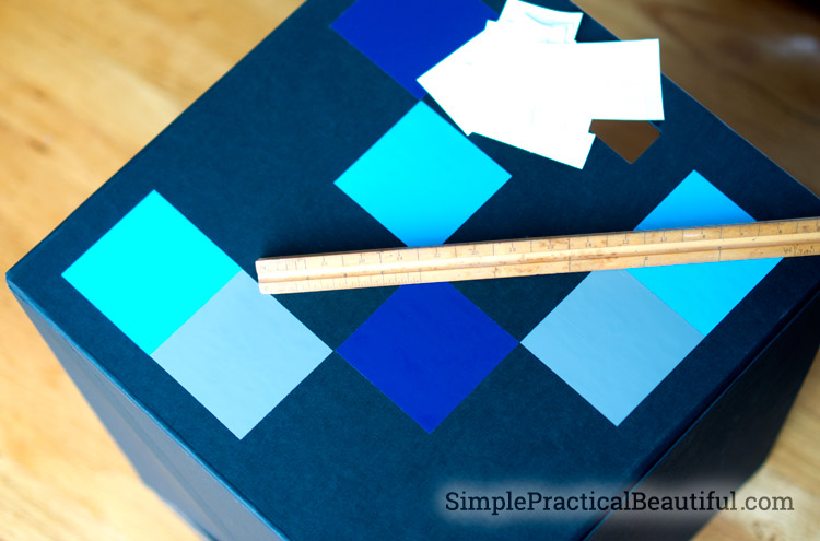 Vinyl squares add color and interest to a storage box