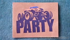 A monster truck party invitation made from cut paper, simple and fun