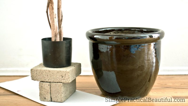Repot a silk tree by creating a base inside the new pot with bricks to give your faux plant the correct height