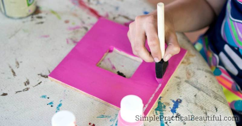 Painting a wooden craft frame with acrylic paint