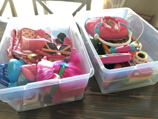 toys sorted into clear plastic storage bins