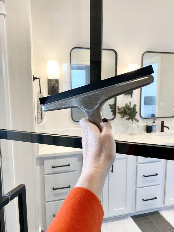 squeegee to remove glass shower door soap scum