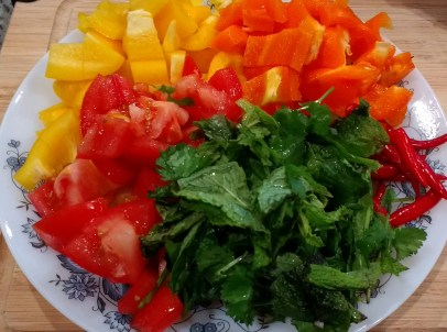 2bellpeppers,1tomato,8red/green chillies(cut into small pieces),mint&cilantro(roughly chop)