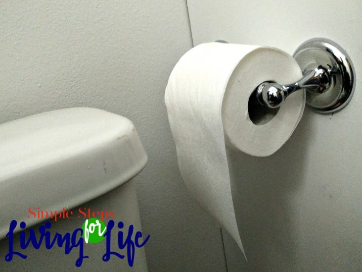 Step by step tutorial on how to install a toilet paper roll.