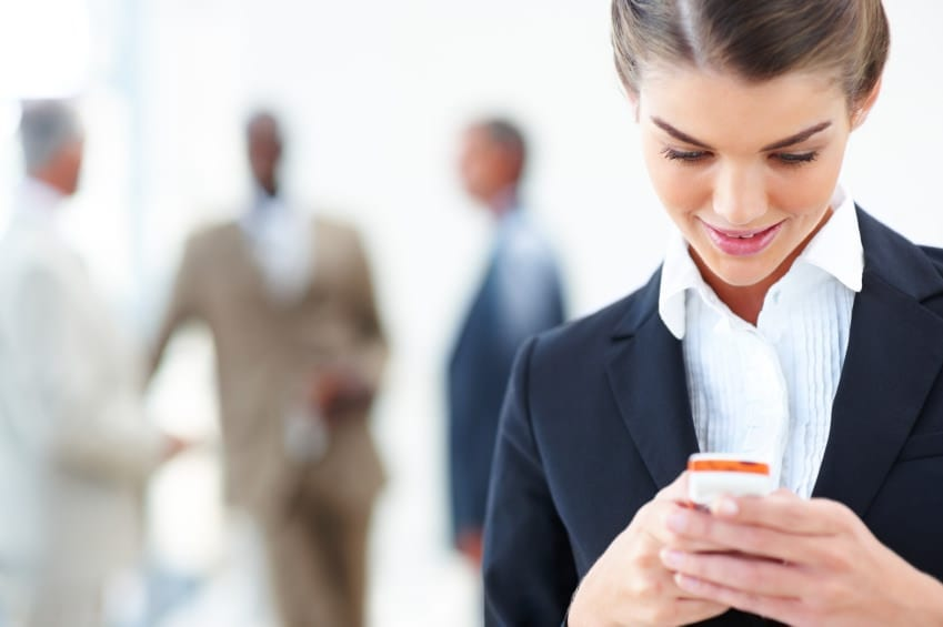 Business Woman using Simple Texting on her phone