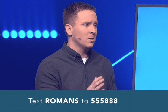 Pastor speaking with text message invitation for Romans reading plan
