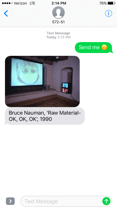 iPhone screenshot showing a 1990 Bruce Nauman artwork of a man's upside down face on a large movie projector