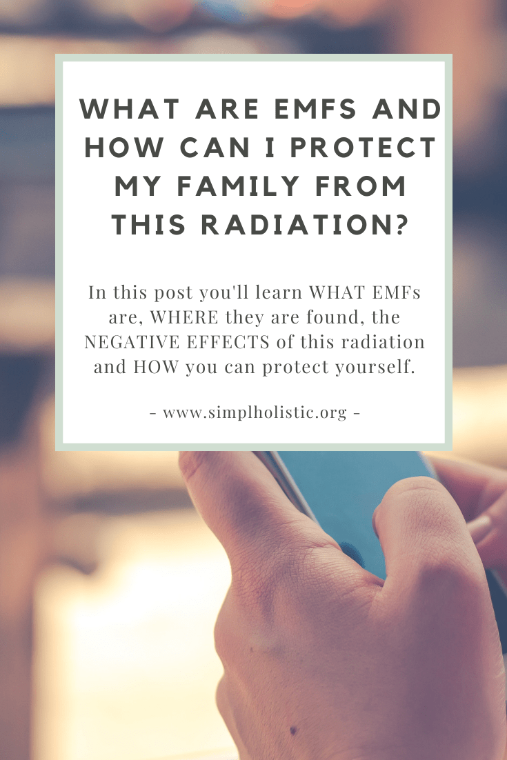 "photo of a hand holding a phone saying ""how can I protect my family from EMFs and what are EMFs"""