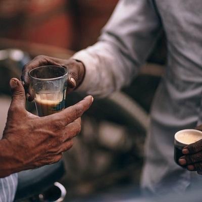Men drinking hot drinks