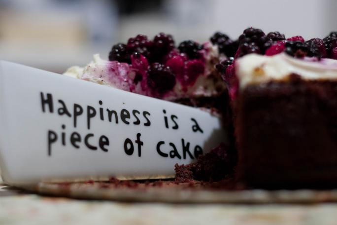 """""""Happiness is a piece of cake"""" note stuck in a cake"""