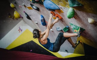 A woman bouldering indoor